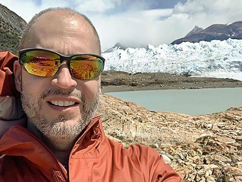Dean with the mighty Perito Moreno Glacier behind him!